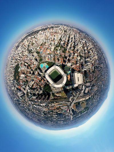 Digital composite image of buildings against blue sky