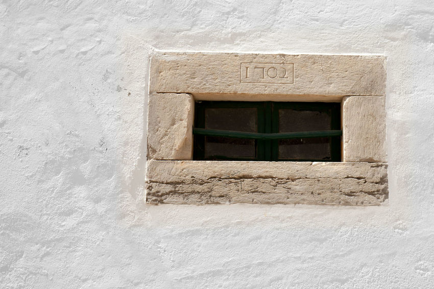 Peephole window Aged Stone Architecture Built Structure Close-up Faro, Portugal History No People Whitewashed Window