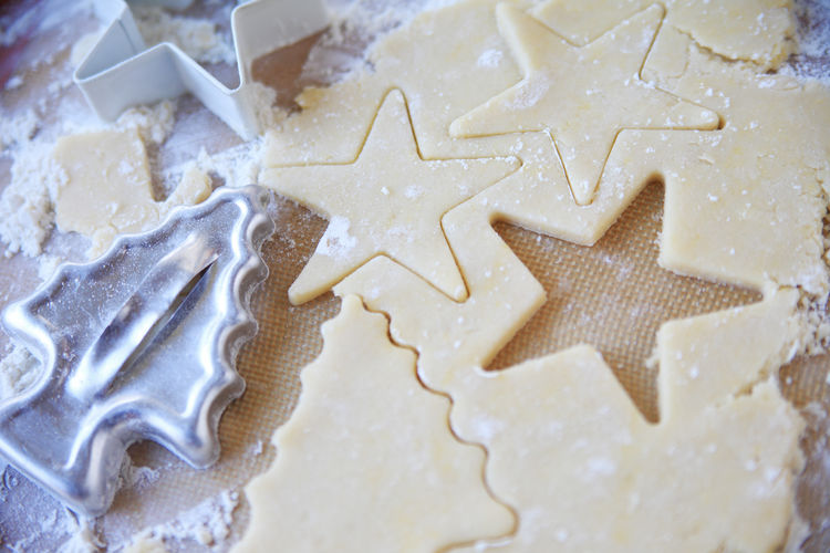 Christmas sugar cookie shapes Backgrounds Baking Beige Tones Christmas Cookies Christmas Tree Shape Cookie Cutters Cookie Dough Food Preparation Geometric Shapes Holiday Food Home Cooking Kitchen Equipment Making Cookies No People Overhead Phone Camera Star Shapes Sugar Cookie Shapes Textures