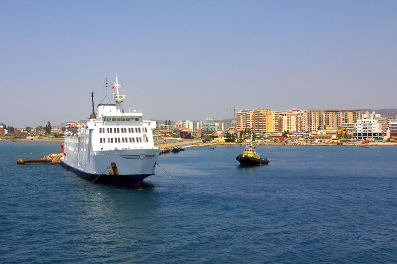 View ships in the port of Valona in Albania ALBANIA❤️ Skyscrapers Valona Architecture Blue Boat And Sea Boats Building Exterior Built Structure City Cityscape Clear Sky Day Landscape Mode Of Transport Nature Nautical Vessel No People Outdoors Sailing Sea Sky Transportation Water Waterfront