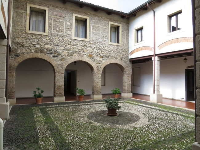 Arch Architecture Cloister Cobbled Pavement Courtyard  No People Outdoors Stone Material Travel Destinations