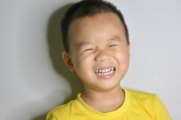 Boys Casual Clothing Child Childhood Close-up Emotion Eyes Closed  Facial Expression Front View Grimacing Happiness Headshot Indoors  Innocence Making A Face Males  Men Mouth Open One Person Portrait Smiling Studio Shot Winking