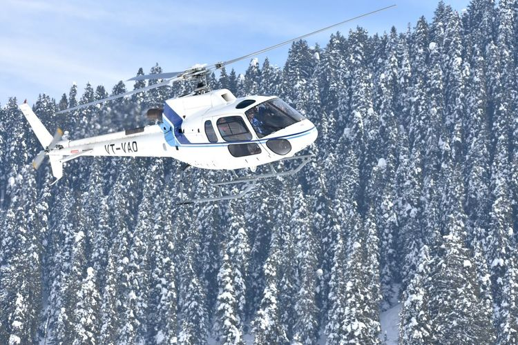 A chopper carrying tourists to the higher reaches at Gulmarg takes off during sunshine Srinagar Kashmir Kashmir , India Snow Snow Winter Sport Ski Holiday Sky Winter Sport