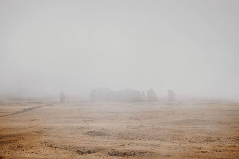 Landscape Against Sky During Foggy Weather
