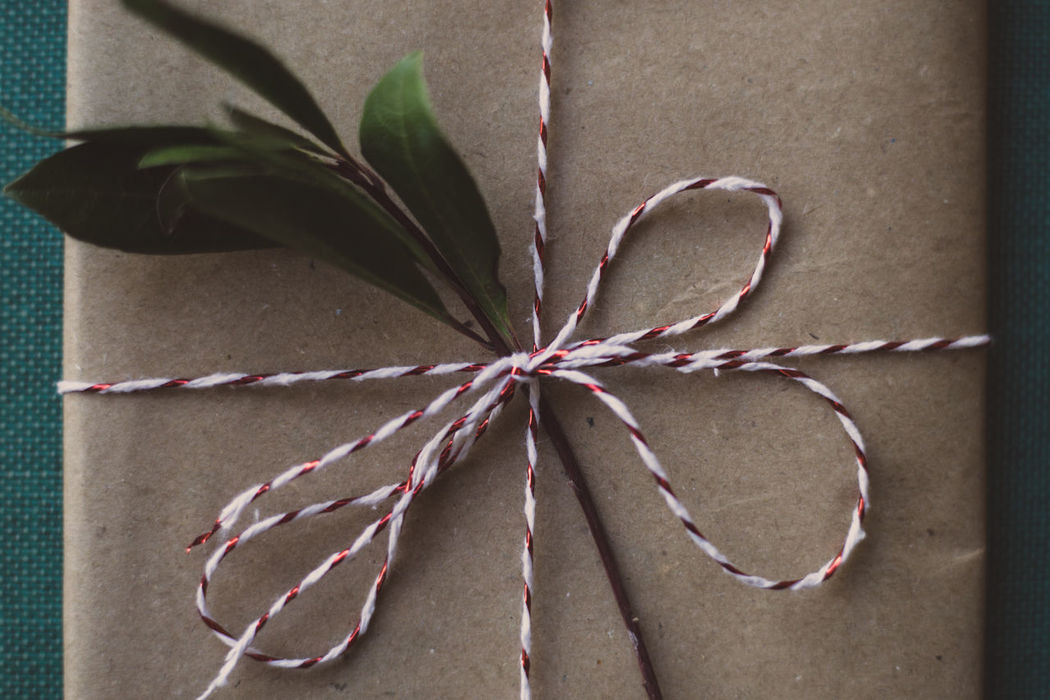 Wrapped gifts on wooden table Christmas Holiday Love Wrap Chritsmas Decoration Gift Paper Wrapped Ribbon No People Close-up Tied Knot Indoors  Ribbon - Sewing Item Tied Bow Day Tying Tied Up