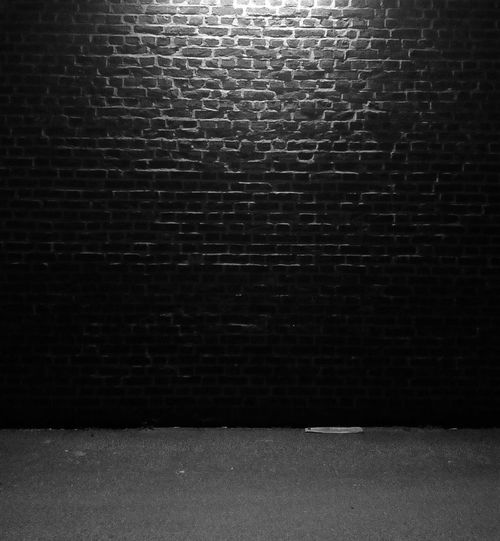 lighted brick wall in the night Brick Wall Wall Light Lighted Lamp Texture Frightening Frighted Crime Dangerous Street Life Urban Textured  Pattern No People Backgrounds Indoors  Close-up Black Background