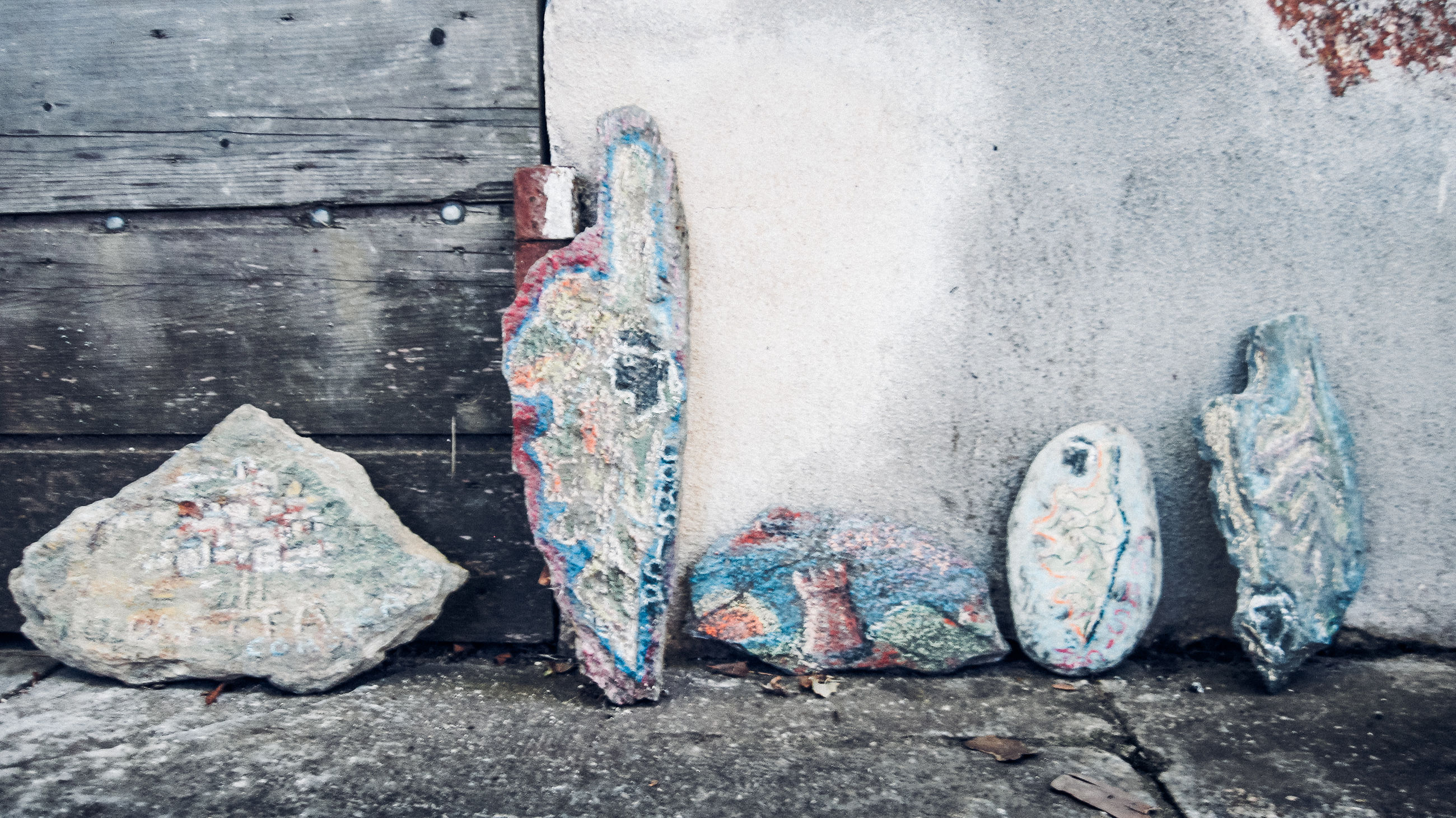 day, no people, outdoors, group of objects, blue, wall - building feature, wood - material, shoe, architecture, textured, close-up, medium group of objects, city, choice, pair, nature, street, variation, paint, concrete