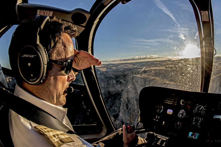 """""""Beyond the Sunset"""" Adventure Aerospace Industry Air Vehicle Airplane Co-pilot Cockpit Dashboard Day Flying Headshot Helicopter One Man Only One Person Only Men Outdoors People Pilot Piloting Sky Transportation Vehicle Interior Window EyeEm Selects"""