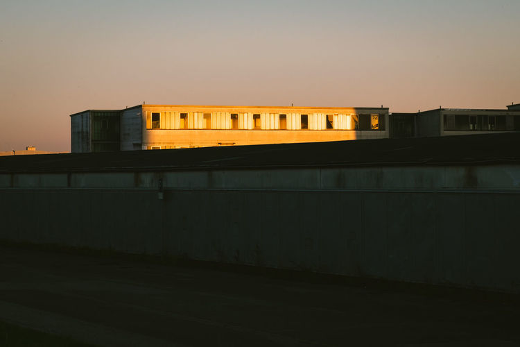 Built Structure Building Exterior Architecture Sky No People Sunset Building Illuminated City Window Outdoors Dusk Wall - Building Feature Wall Orange Color Night Clear Sky Copy Space