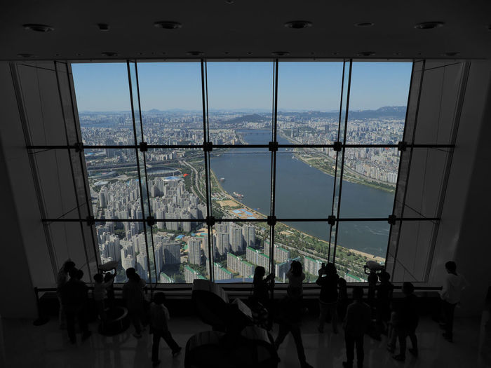 Seoul Birdview Indoors  River Panorama City View Viewpoint People Skyscraper Daylight Tourism Architecture Built Structure City Cityscape Day Glass - Material Group Of People Indoors  Transparent Window Office Building Building Urban Skyline International Landmark Skyline Point Of View High Tall - High