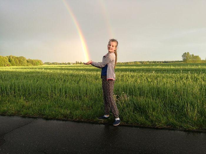 Portrait of girl standing in farm