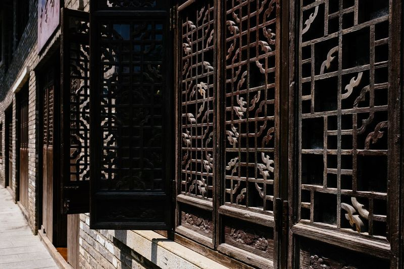 window Chinese Window Decoration Architecture Built Structure No People Building Exterior Metal Day Wall - Building Feature Building Pattern Door Outdoors Entrance Graffiti Run-down Text Old Art And Craft Abandoned Sunlight Weathered