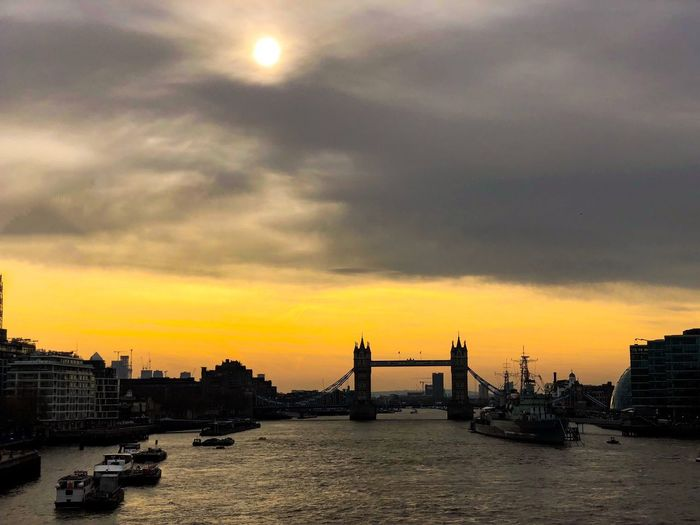 Good morning London Dawn Yellow Sun Sunrise Mobilephotography IPhoneography ShotOnIphone Uk London Tower Bridge  Sky Water Cloud - Sky Sunset Architecture Nature Nautical Vessel Silhouette Bridge Travel Destinations Cityscape City Outdoors
