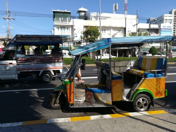 tuk tuk on the road in Thailand TukTuk Tuktuk Thailand Tuktuk Streets Tuktuklovers Tuktukdriver Tuktuklovers Street Mode Of Transport Transportation City Day Sky Outdoors No People