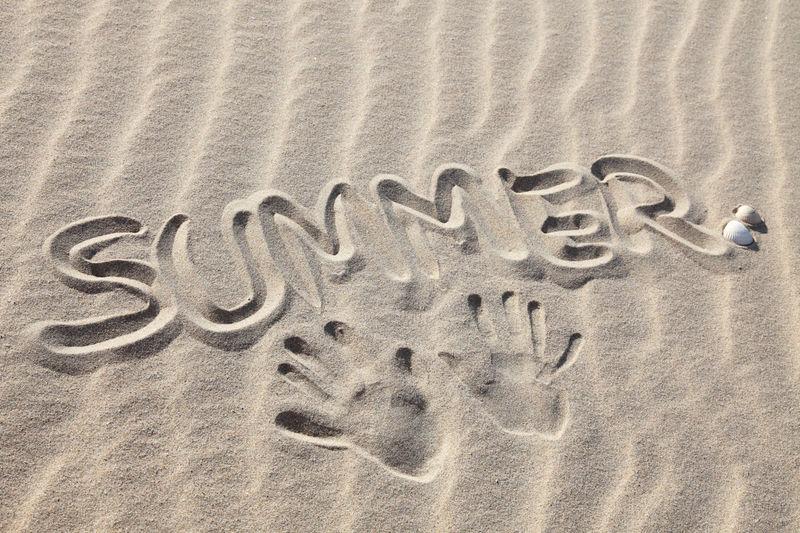The term summer written in the sand Beach Beach Photography Creativity Sand Summer SUMMER BREAK Summer Holidays Summer Season Summertime Symbolic  Vacation