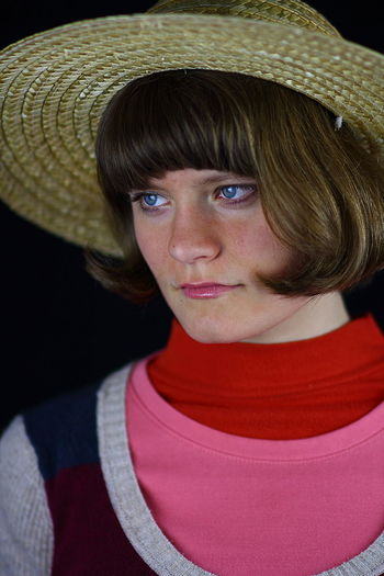 Close-up of young woman wearing hat