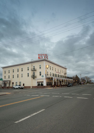 Hotel Niles in Alturas, a small town in Northern California, USA, population of 2500. Transportation Sky Cloud - Sky Building Exterior Architecture Road Built Structure City Nature Sign Street Mode Of Transportation Hotel Hotel Niles Alturas California Community Rural America Rural Scene Rural Small Town Stories Small Town USA Small Town America Travel Destinations Travel