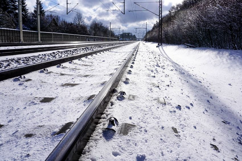 rail Cold Temperature Diminishing Perspective Eye4photography  High Angle View Perspective Railroad Track Railway Track Straight The Way Forward Train Winter Flusimans_getty