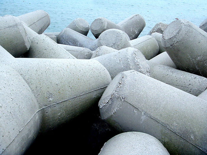 Barrier Concrete Blocks Constructions Grey And Blue No People Outdoors Seashore Shapes And Forms Waterfront