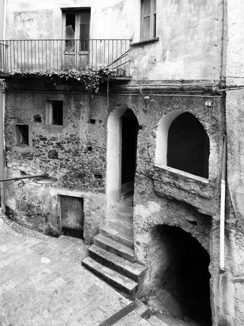 Glimpse of the historic center of Verbicaro Black & White Historic City Italia Old Town South Italy Architecture Balcony Black And White Black And White Photography Building Exterior Built Structure Calabria Door Glimpse History Outdoors Staircase Steps Steps And Staircases Travel Destination Verbicaro Window