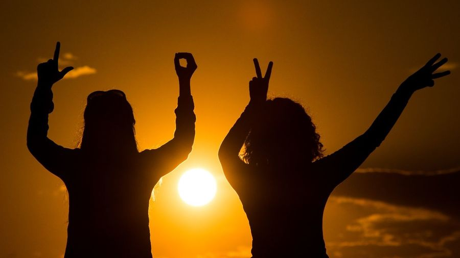 Silhouette Of Women Having Fun