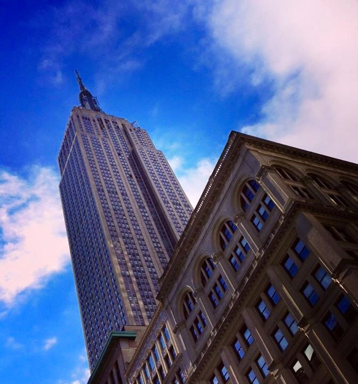 architecture, low angle view, building exterior, built structure, sky, skyscraper, day, outdoors, city, cloud - sky, no people, travel destinations, blue, modern