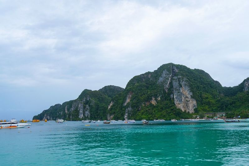Phi Phi Island Thailand Phi Phi Island Water Sky Beauty In Nature Nautical Vessel Sea Waterfront Cloud - Sky Outdoors Travel Day Nature Transportation Mountain