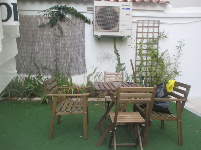 Beautiful Cafe Cafe Cafe Surrounded With Plants Chair Chair And Table In The Garden Dark Green Day Empty Cafe Garden Cafe Grass Growing Plants Growth Indoors  Nature No People Plant Plants Pleasure Potted Plant Table Tree Wood - Material Wood/ Material Woodden Chairs Woodden Table