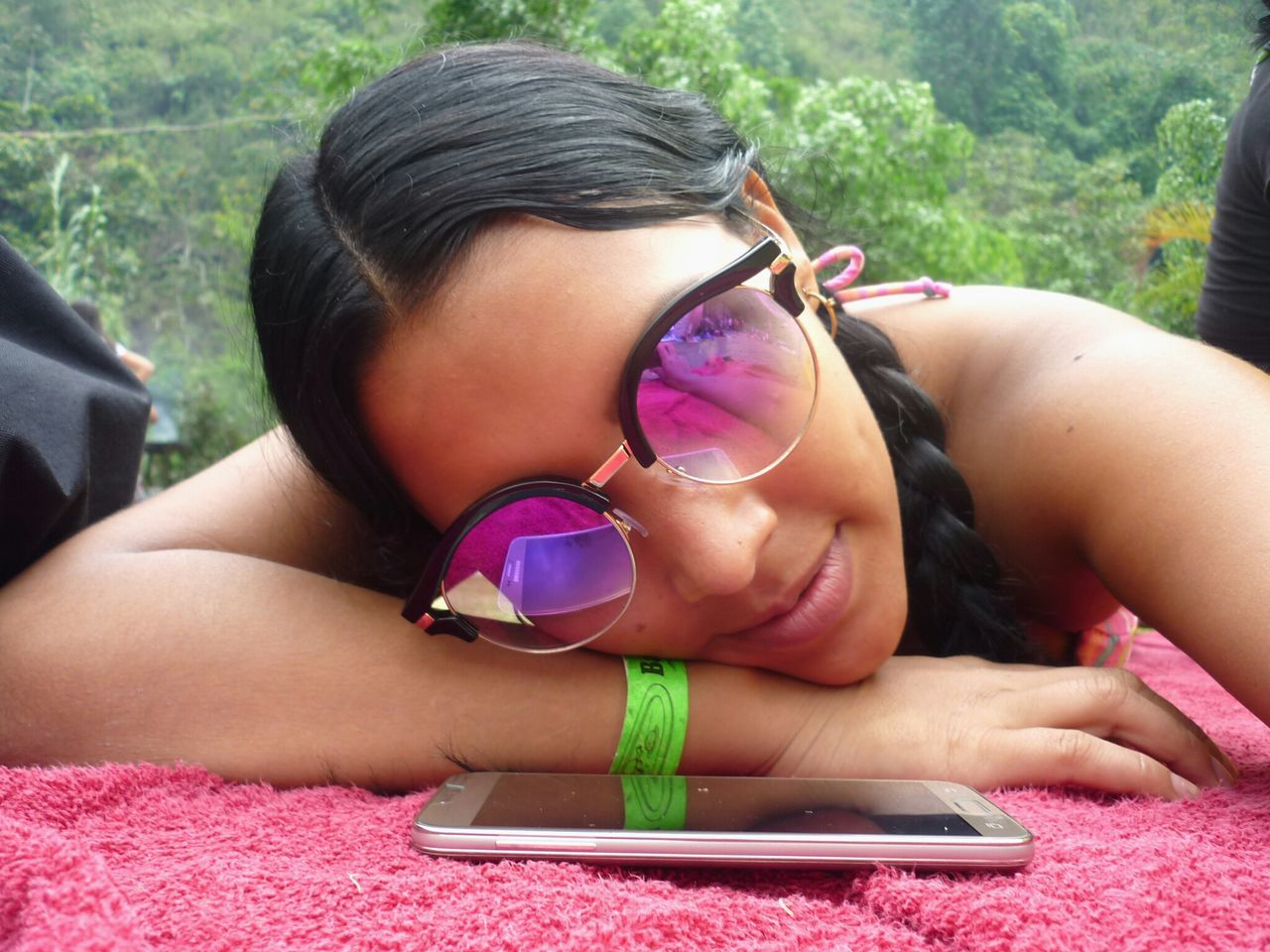 real people, technology, wireless technology, lifestyles, leisure activity, portable information device, one person, young adult, communication, young women, mobile phone, lying down, day, beautiful woman, outdoors, close-up