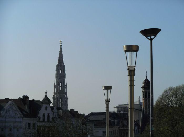 Street amidst buildings against clear sky