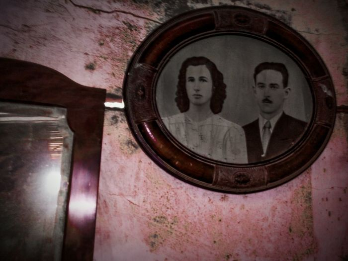 Old photo in abandoned house. Old Photo Cracks In The Wall Past Deteriorated Photo Expression Historic