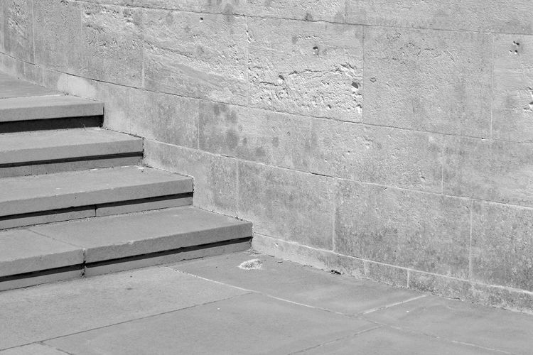 Stairs By The Wall Architecture Blackandwhite Building Exterior Built Structure Concrete Day Empty Outdoors Pattern Staircase Steps And Staircases Textured  Wall Wall - Building Feature