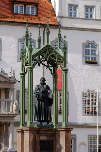 Statue of Martin Luther the reformator in Wittenberg, Germany Architecture Art And Craft Bible Bronze Building Exterior Built Structure Day Germany History Human Representation Lutherstadt Martin Luther Monk  No People Outdoors Protestant Reformer Religion Residential Building Sculpture Statue Theologian Travel Destinations Window Wittenberg