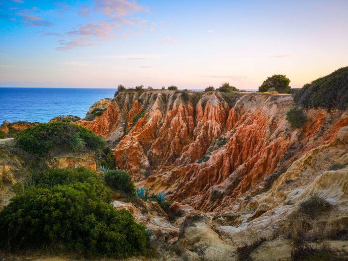 Red cliffs Cliffs Cliff Praia Da Marinha Huaweiphotography Nature Photography EyeEm Nature Lover Beach Sunset Sea Multi Colored Sky Horizon Over Water Landscape Rock Formation Eroded Natural Arch Canyon Natural Landmark Coast Geology Scenics Idyllic Shore Rock Physical Geography Rocky Mountains Rugged Limestone Geyser Arid Climate Stay Out The Mobile Photographer - 2019 EyeEm Awards