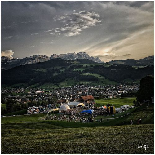Clanx Openair Appenzell Landscape Sky Mountain Beauty In Nature Field Nature Scenics Men Outdoors Agriculture Real People Women Building Exterior Large Group Of People Mountain Range Built Structure Architecture Day Grass People