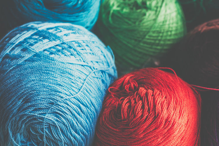 Thread Silk Colors Art And Craft Ball Of Wool Blue Close-up Craft Creativity Focus On Foreground High Angle View Indoors  Jeans Material Multi Colored No People Pattern Red Silk Softness Sphere Still Life Textile Thread Wool