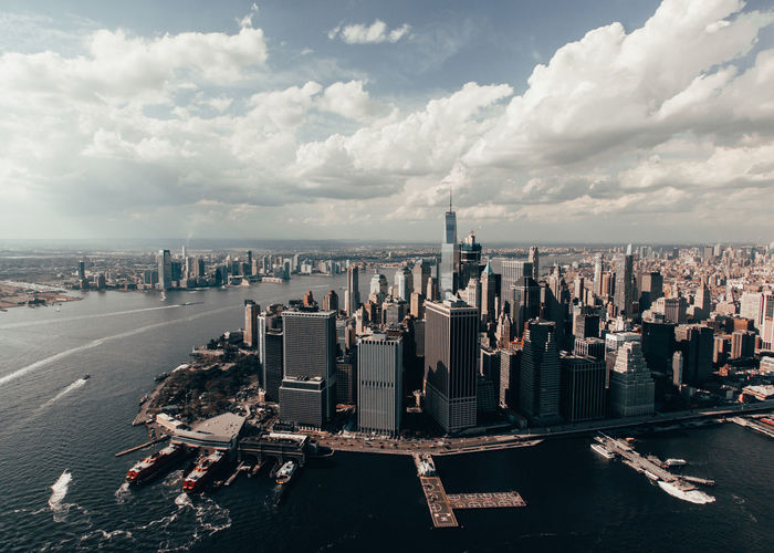 Panoramic view of city buildings against cloudy sky new york city