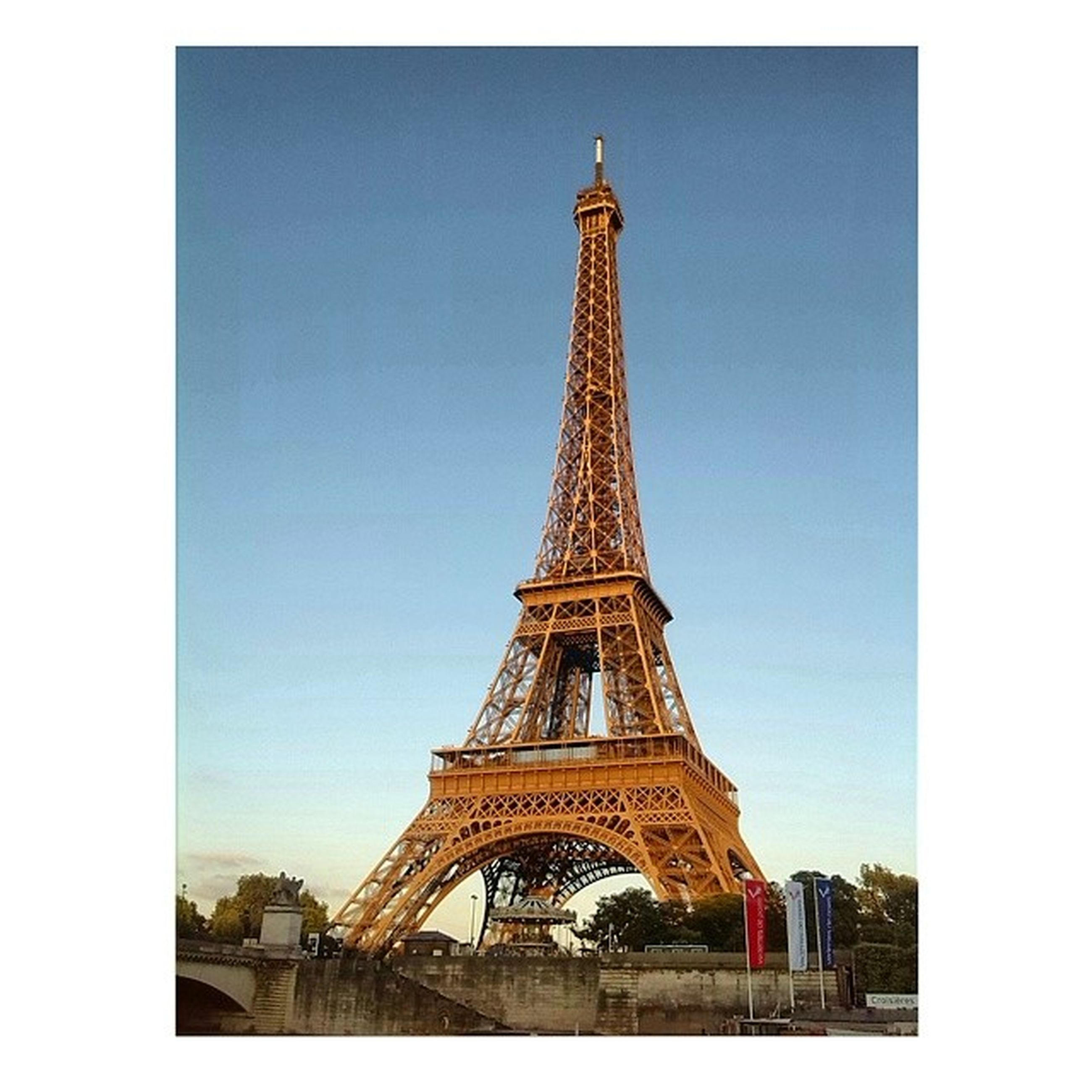 transfer print, architecture, built structure, eiffel tower, tower, famous place, international landmark, travel destinations, auto post production filter, building exterior, capital cities, tourism, tall - high, culture, travel, clear sky, history, low angle view, city, sky