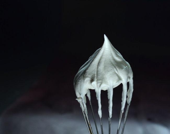 Close-up of cream on whisk