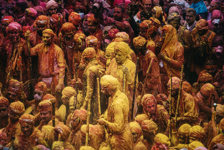 People playing holi in city