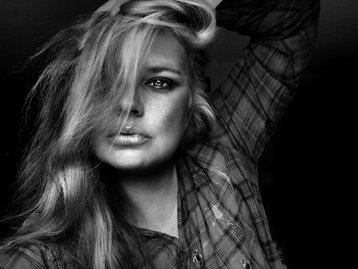 Close-Up Portrait Of Beautiful Woman Against Black Background