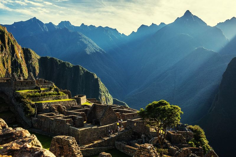Peru Machu Picchu Sunset at Machu Picchu, Peru. Mountain of Huayna Picchu rising above Incan ruins of Machu Picchu - Sacred Valley. america Ancient Andes Architecture building culture Cusco history Inca landmark landscape Latin Machu Machu Picchu mountain old buildings Past Peru Picchu Ruins South southamerica tourism Tourist Travel Peru Machu Picchu