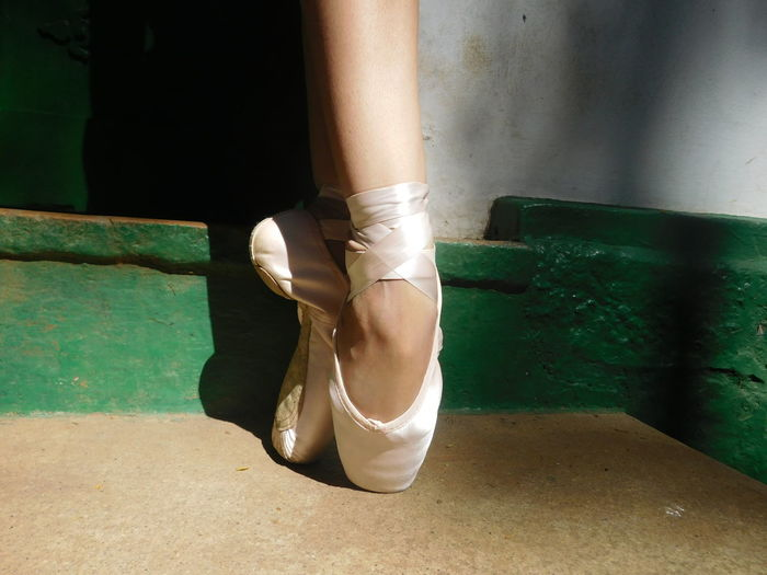 Low section of ballerina standing on tip toes