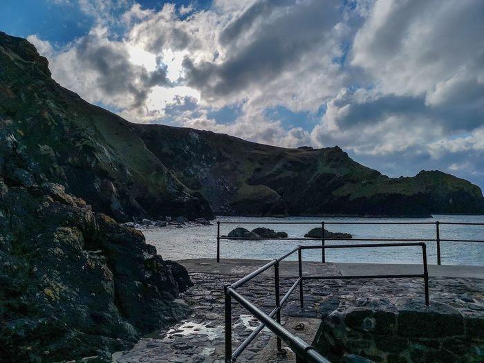 a cold day at mullion cove South West Coast Path Britain Landscape_Collection Mullion Cove Cornish Coast Railings Water Sea Tree Beach Sky Tranquility Shore Non-urban Scene Scenics