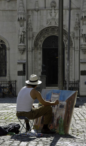 Artist Painting Easel Painting In Street Young Man Hat Historic Building Cobblestone Square Morning Sunshine Art Painter Brazil Adventures In The City