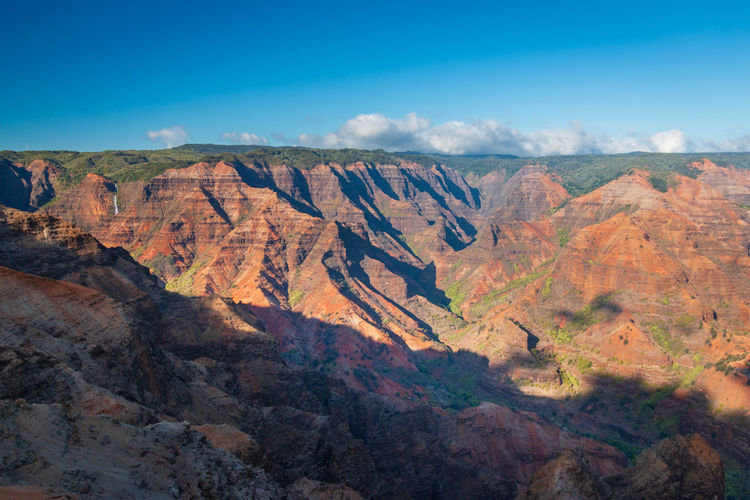 Scenic view of waimea canyon, kauai, hawaii, usa seen from waimea canyon lookout against sky