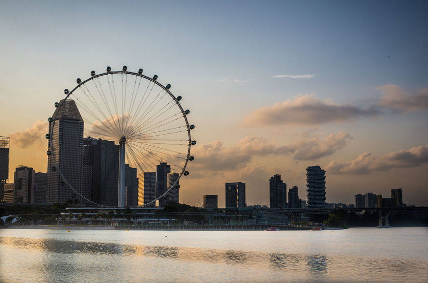 Sunset on a warm day Architecture City Life Cityscape Cloud Cloud - Sky Garden By The Bay Landscape Marina Bay Sands Nature Nikon Observation Wheel Sing Sky Sunset Tourism Water Singaporeflyer