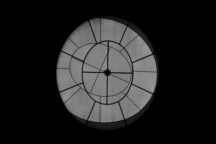 Low angle view of clock in darkroom