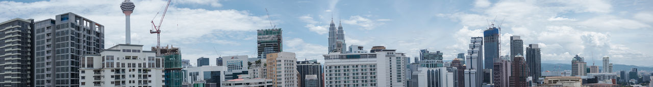 KL skyline on a day without haze Architecture Building Building Exterior Built Structure Capital Cities  City City Life Cityscape Cloud - Sky Cloudy Day Development Financial District  Kuala Lumpur Modern No People Office Building Outdoors Sky Skyscraper Tall Tall - High Travel Destinations Urban Skyline