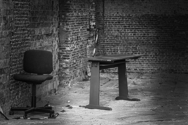 EyeEm Best Shots - Black + White Blackandwhite Restoration Seat Wall Wall - Building Feature Brick Wall Chair Day No People Brick Old Absence Built Structure Wood - Material Architecture Empty Abandoned Bench Outdoors Table